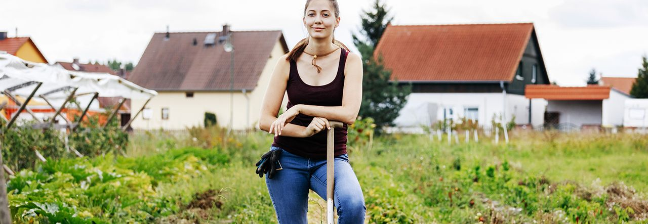 Female farmer with one food on a garden fork